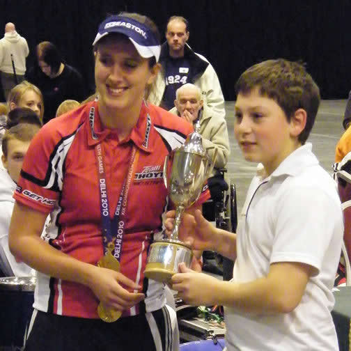 Ladies Compound World Number 1 Nicky Hunt congratulates Jamie Cole of Chichester Bowmen on taking first place in the Under 14 Compound